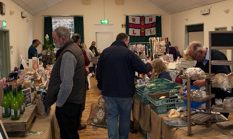 https://northwoottonvillagehall.org.uk/wp-content/uploads/2019/03/NWVH21-North-Wootton-Village-Market-Village-Hall-Kings-Lynn-Norfolk-Event-Venue-Hire-Farmers-Market.jpg