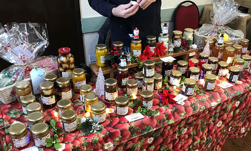 https://northwoottonvillagehall.org.uk/wp-content/uploads/2019/09/Christmas-Fair-2019-07-Joyces-Jams-Chutneys-Craft-North-Wootton-Village-Market-Village-Hall-Kings-Lynn-Norfolk-Event-Venue-Hire.jpg