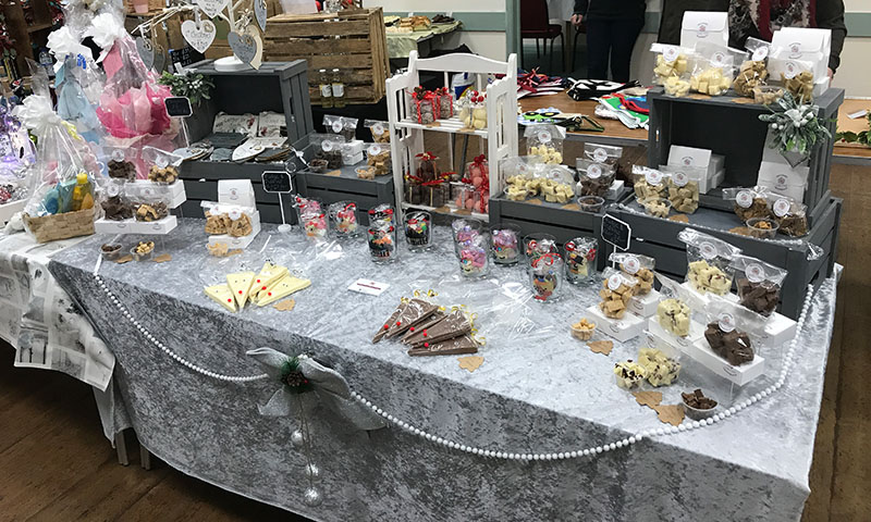 https://northwoottonvillagehall.org.uk/wp-content/uploads/2019/09/Christmas-Fair-2019-11-Syncerly-Synful-Fudge-Craft-North-Wootton-Village-Market-Village-Hall-Kings-Lynn-Norfolk-Event-Venue-Hire.jpg