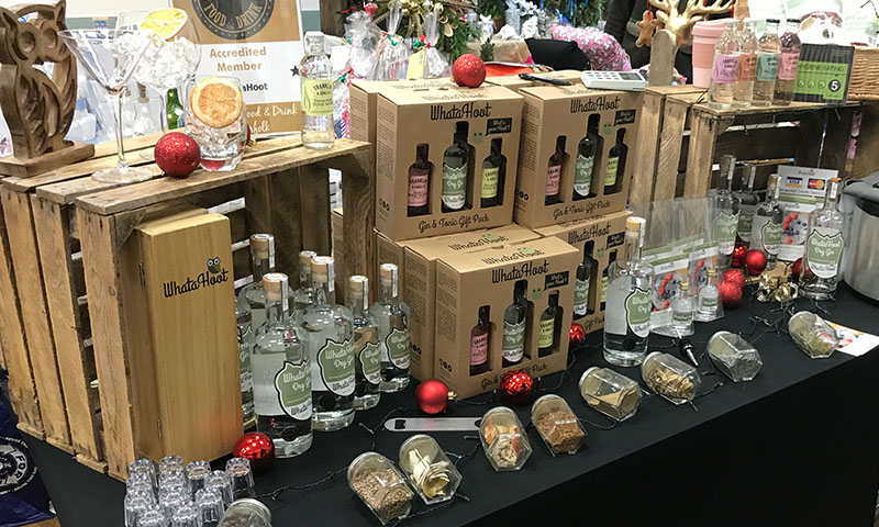 https://northwoottonvillagehall.org.uk/wp-content/uploads/2019/09/Christmas-Fair-2019-15-WhataHoot-Gin-Craft-North-Wootton-Village-Market-Village-Hall-Kings-Lynn-Norfolk-Event-Venue-Hire.jpg